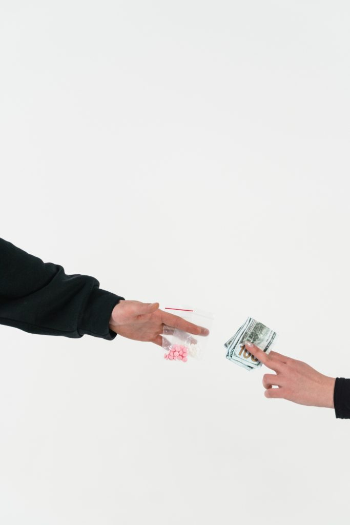 person exchanging money for possession of a controlled substance