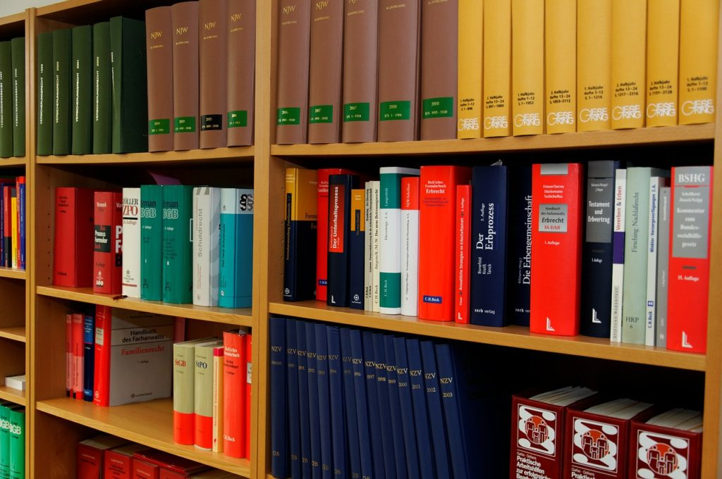 books that belong to a Columbus, Georgia Criminal Appeals Lawyer are stacked on shelves