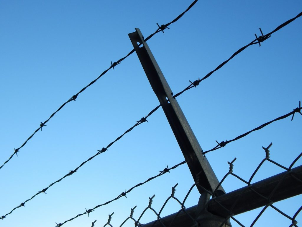 barbed wire fence enclosing inmate because they were unaware of Georgia drug schedules