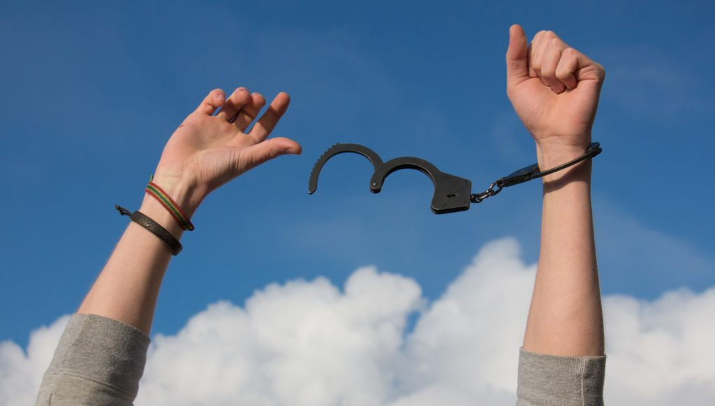 handcuffs breaking free as our criminal defense attorney got a client out of jail in Muscogee County, Georgia