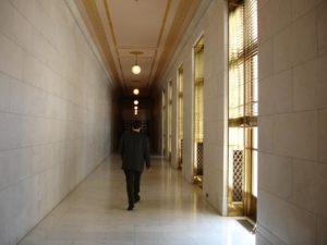 man walking down hallway to get to his bench trial where his good attorneys in columbus georgia are