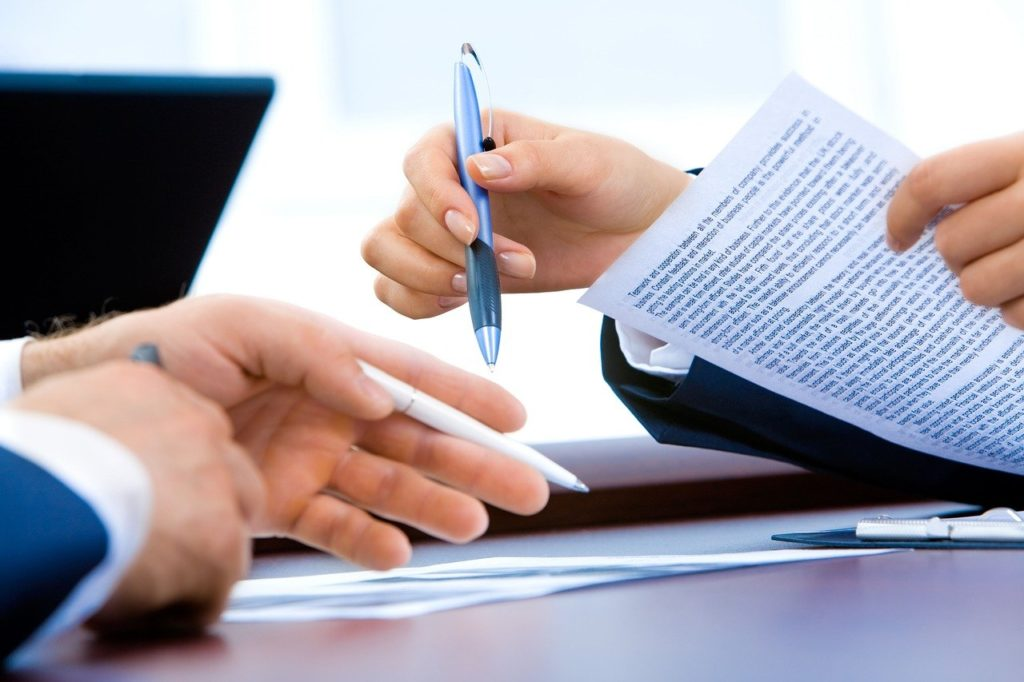 business lawyer in georgia drafting contract for different types of business entities
