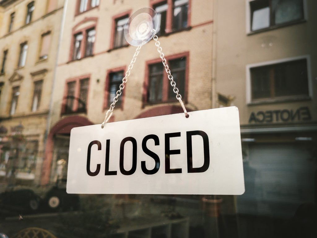 business with closed sign after they led the company through business closures